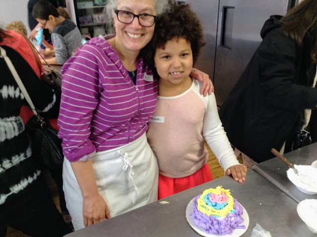 Cake decorating at Wild Flour Bakery for Mother's Day