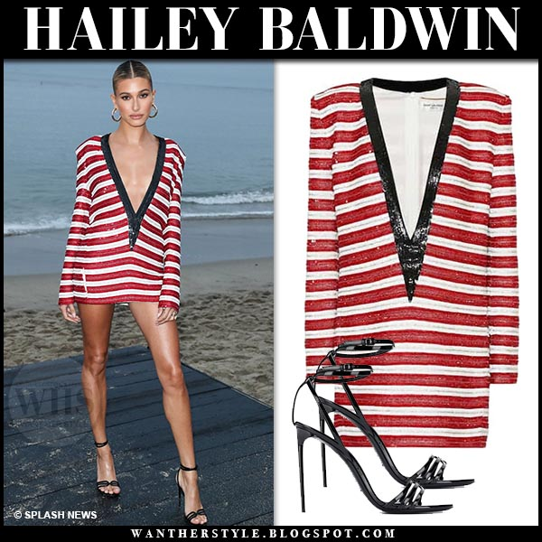 a4e92cd10567 Hailey Baldwin in striped red sequin mini dress and black sandals.  celebrity summer party style