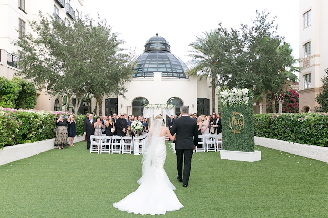 bride walking down aisle at the alfond inn