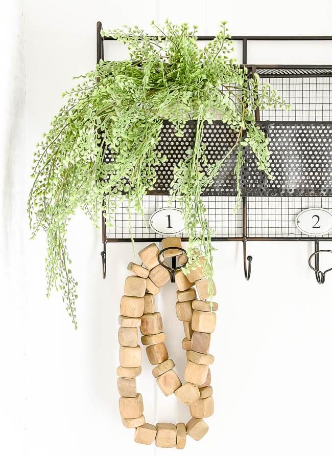 Wood garland decor on mudroom hooks