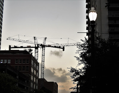 Duo of Cranes, arms crossed in the Theater District - Downtown Houston