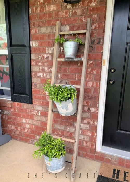 New uses for vintage goods in home decor  |  wooden ladder to hold plants