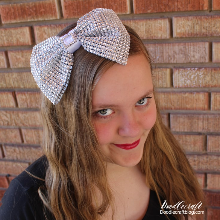 giant rhinestone hairbow attached to headband