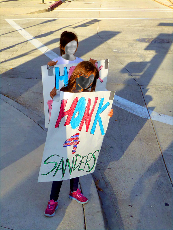 two young girls holding Honk for Sanders signs - voter registration - Pasadena CA