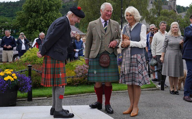 Duchess of Cornwall wore a chic check dress that featured a unique grey waistcoat style top