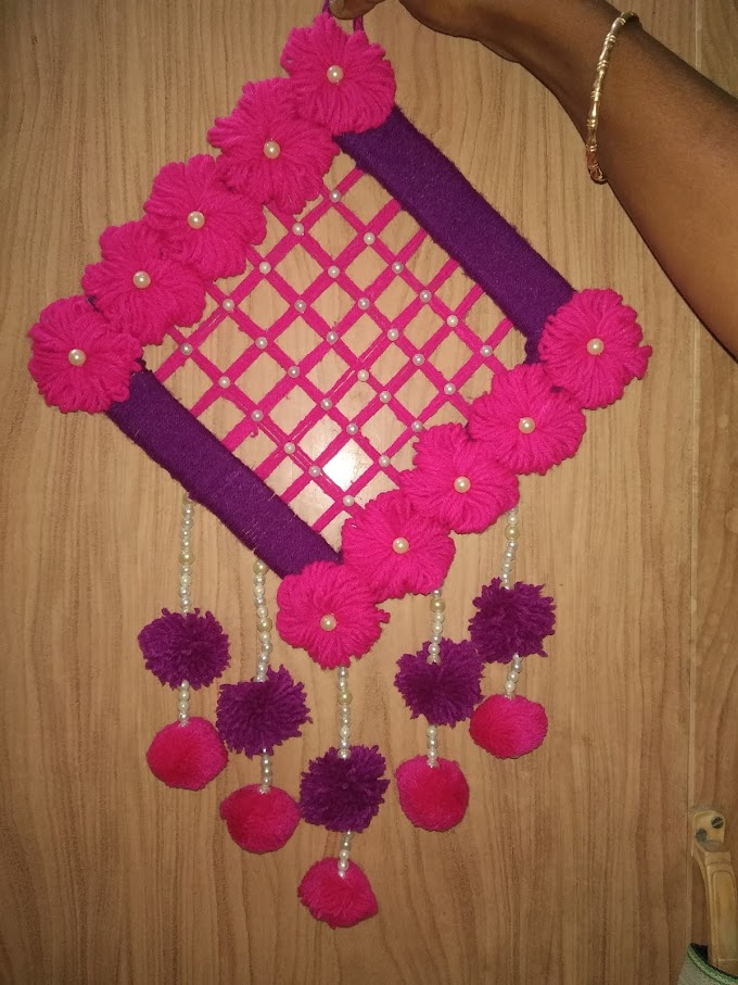 Woolen wall hanging 5 in telini para by Arpita Roy