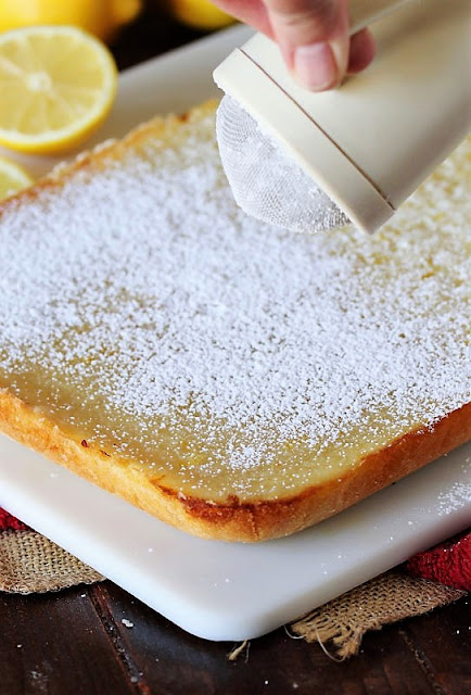Dusting Lemon Bars with Confectioners Sugar Image