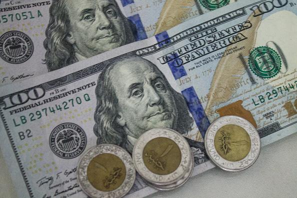 هل يصل سعر صرف الدولار إلى 18 جنيه مقابل الجنية المصري بسبب كورونا
