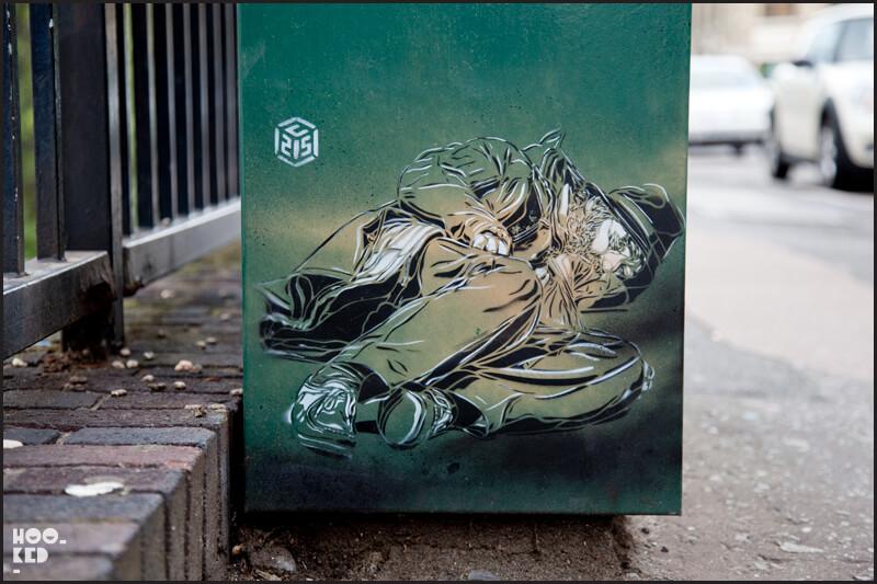London street art, sleeping homeless man stencil by artist C215