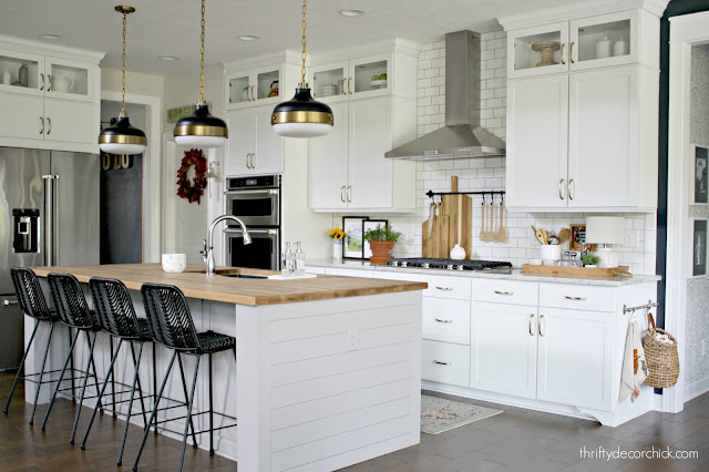 White kitchen light gray island with butcher block counters