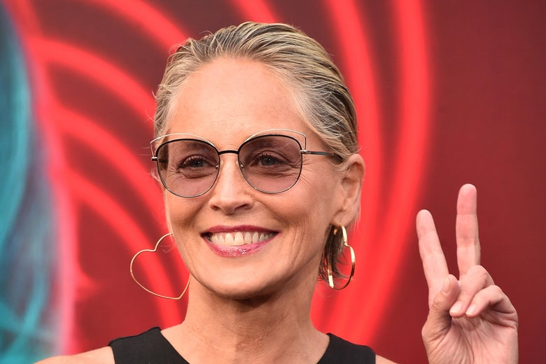 Sharon Stone wearing heart-shaped hoop earrings