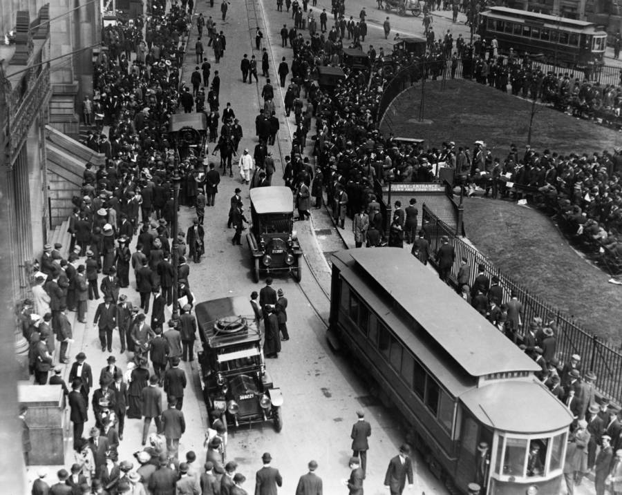 Crowds wait outside the White Star Line office
