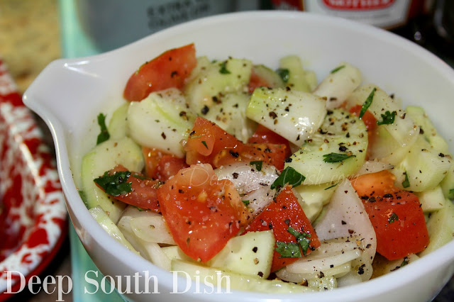 A favorite simple salad in the summer, featuring garden fresh cucumbers and tomatoes, red or sweet onion, and dressed in a simple homemade vinegar and olive oil Italian dressing.