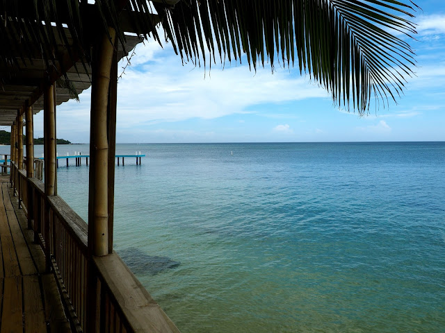 Ocean view from wooden bridge leading to West Bay Beach, Roatan Island, Honduras