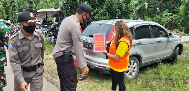 Polsek Patangkep Tutui Bersama Petugas Gabungan Laksanakan Ops Yustisi Covid-19