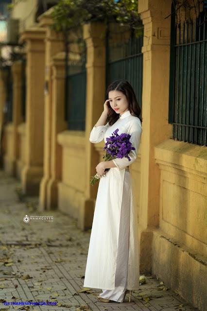 Vietnamese teen girl walking on the street with white ao dai 6