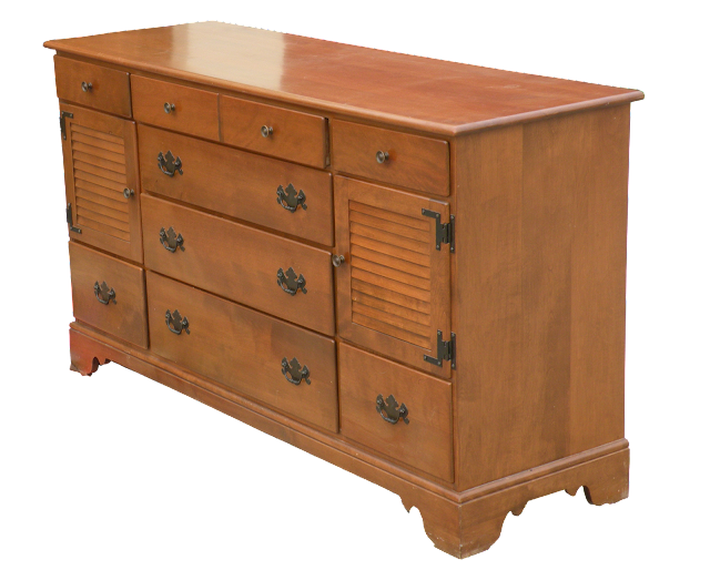 A side view of a solid maple dresser; factory-made in the early 1950s, it was a popular style.