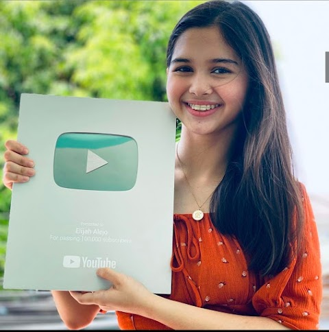 Elijah Alejo receives her Youtube Silver Play Button after almost a decade