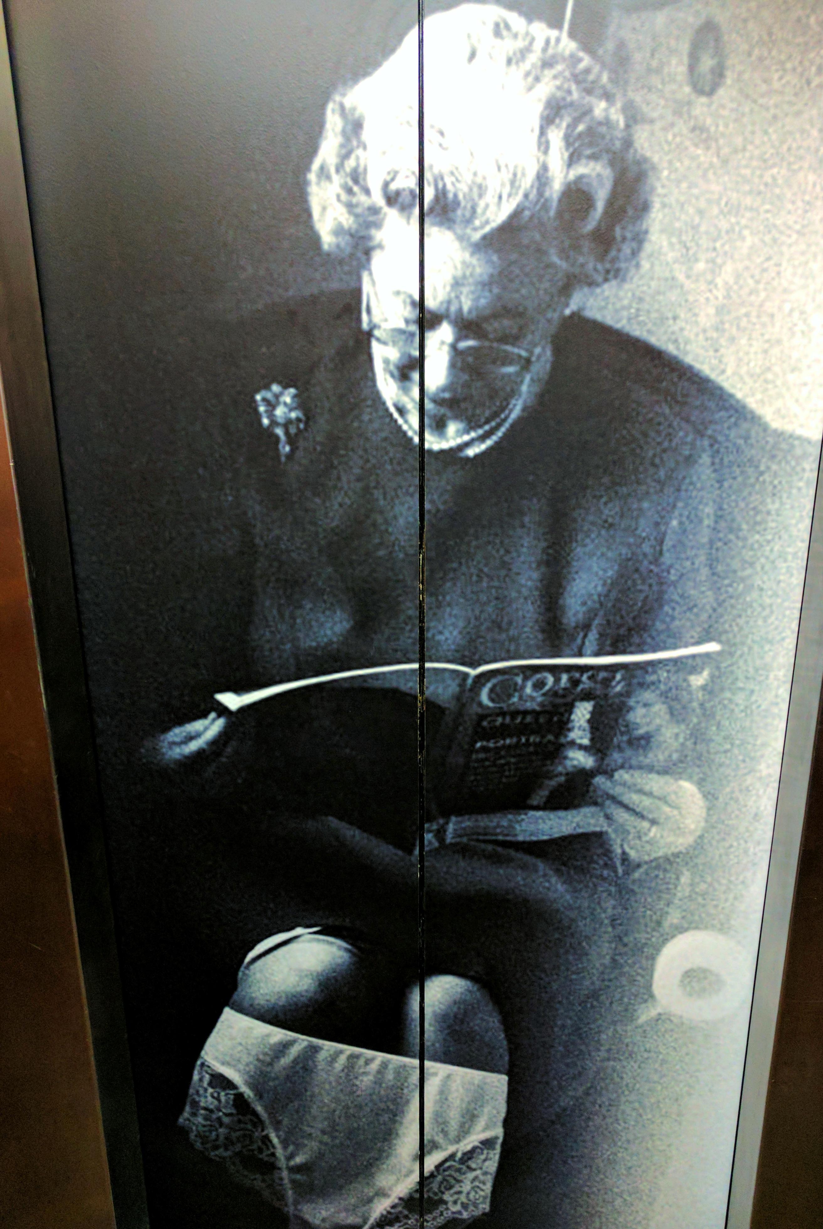 Comedy poster of Queen Elizabeth II on the toilet