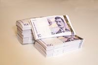 1 mill kr i tusensedler Foto: Nils S Aasheim, Norges Bank, Lisens: CC by-nd 2.0.jpg