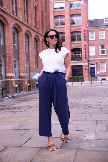 woman in navy culottes and white T-shirt
