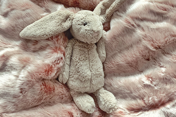 Grey jellycat rabbit on Dusky blush rose pink and grey faux fur