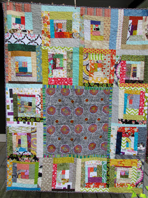 improv log cabin, a quilt for community service - Marty Mason