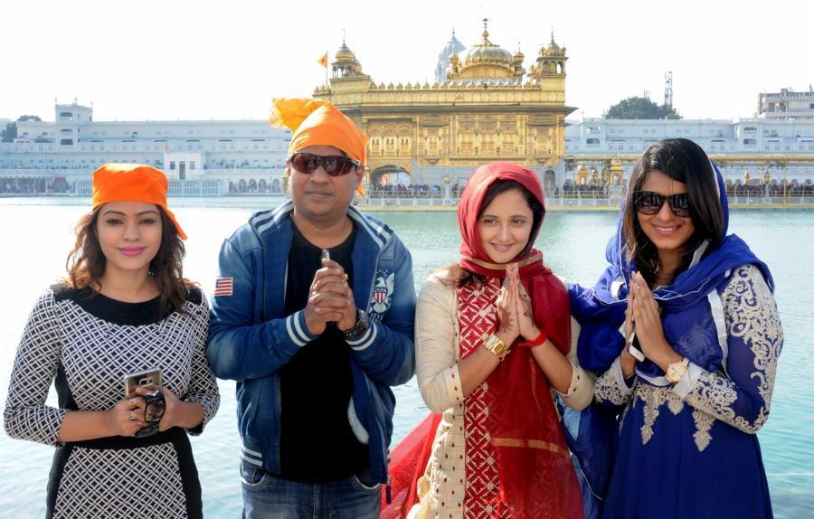 Hindi TV Actress Rashami Desai Photos In Red Dress At Golden Temple