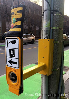 Accessible Pedestrian Signal with a tiny yellow boot on top