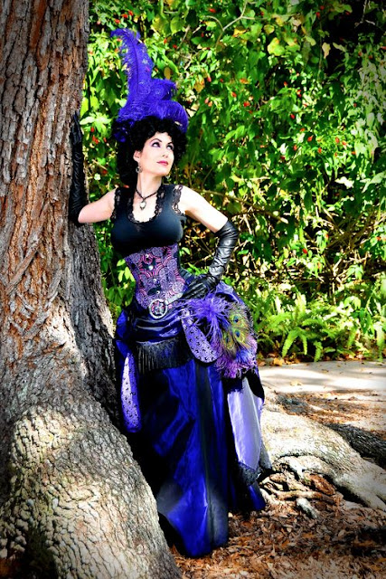 women's steampunk clothing and costume inspiration. Comic book arthurian Legend/avengers cosplay in purple ostrich feather plumes and peacock feathers