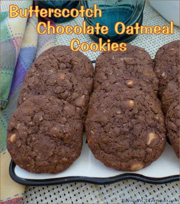 Butterscotch Chocolate Oatmeal Cookies are crispy on the outside, chewy on the inside chocolate flavored oatmeal cookies studded with little bursts of butterscotch. | Recipe developed by www.BakingInATornado.com | #recipe #cookies