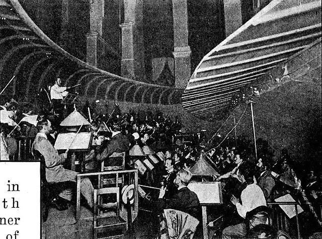 a 1921 orchestra pit in a large theatre, a photograph