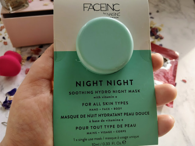 Hand holding Face inc Night Mask, in a blue and white packet