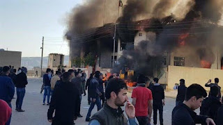 Protestors torch offices of Kurdish parties in northern Iraq
