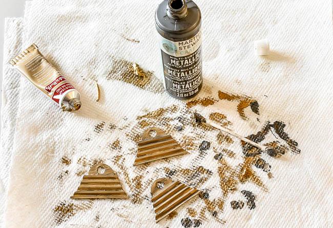 Adding rub 'n buff and metallic paint to ornament hardware