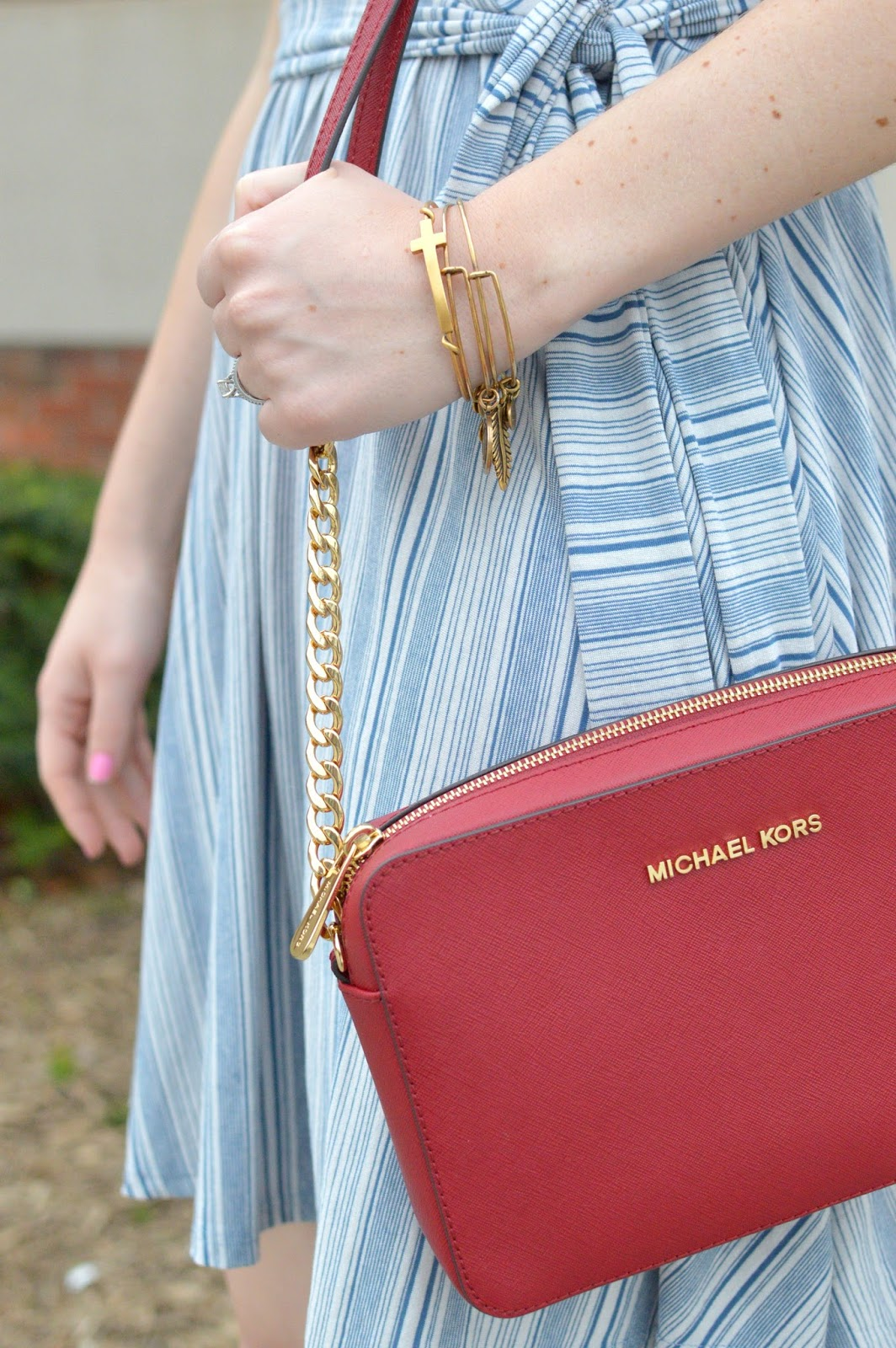 red michael kors purse and alex and ani cross bracelet