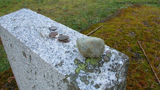 coins on tombstone