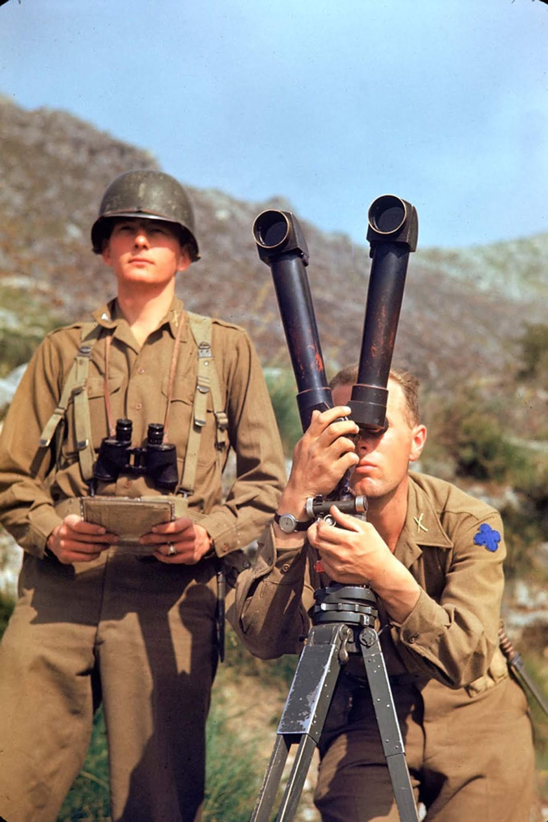 An American soldier tried to spot German positions during the Allied drive towards Rome, 1944.