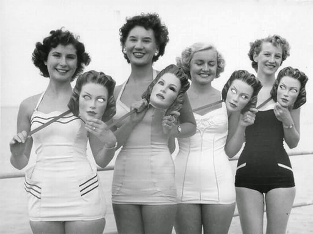 a5f18908bb Ladies in bathing suits with creepy masks