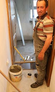 Bekir making a start on tiling the corridor