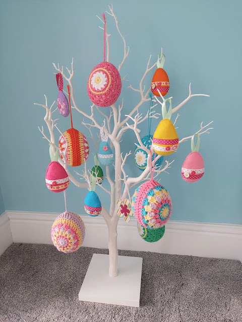 Colourful crochet and felt eggs on a pretty white Easter tree