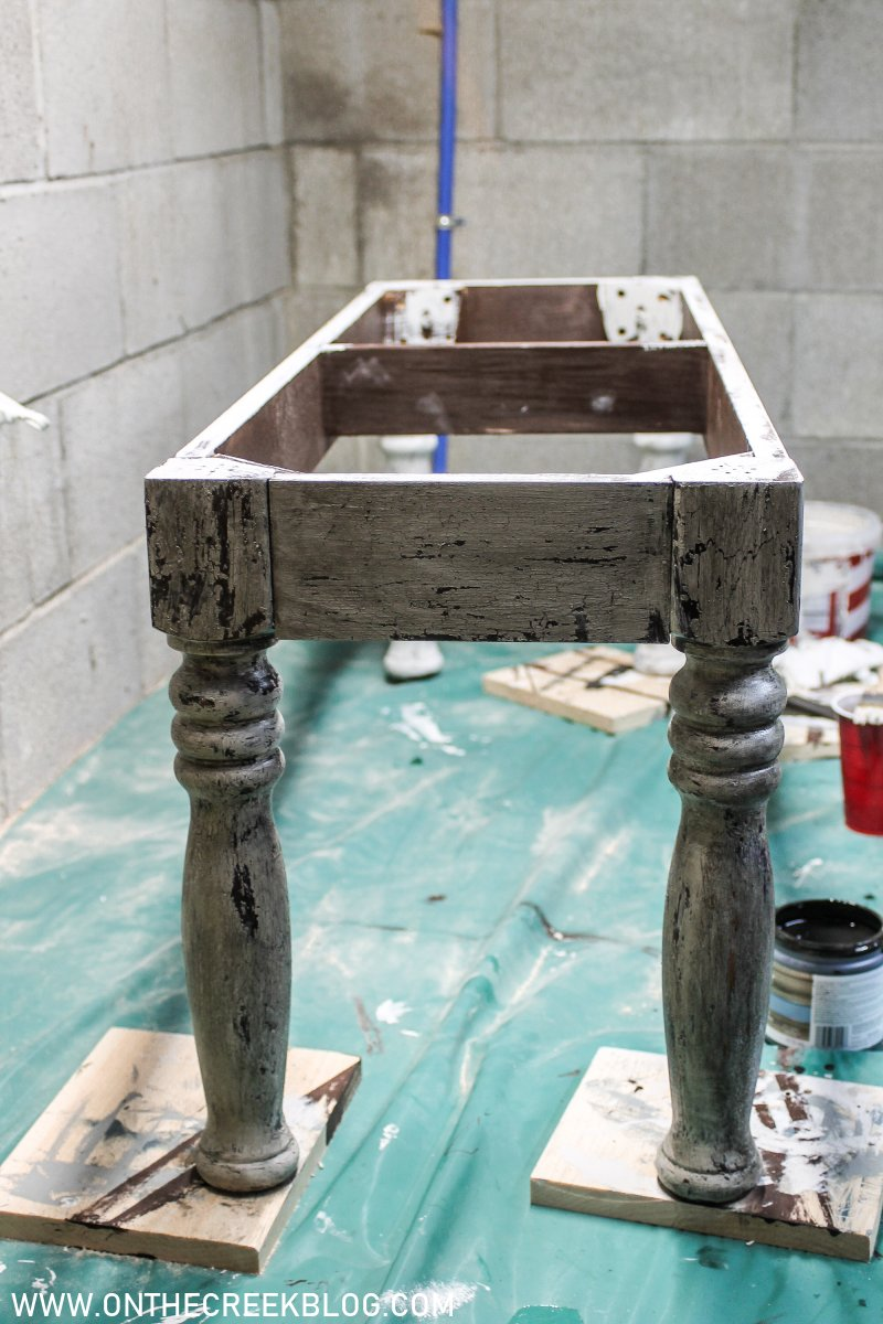Painting our upcycled DIY dining bench using crackle glaze & custom stain! | On The Creek Blog