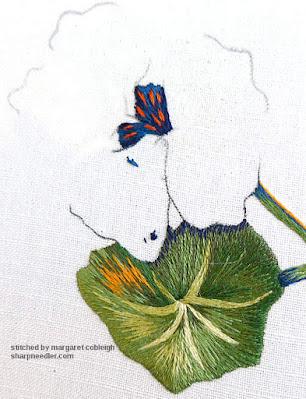 Blue needlepainged embroidery centre on the main nasturtium flower. (Catherine Laurencon Capucines (Inspirations))