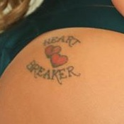 """""""Heart Breaker"""" above and below two red hearts on right butt cheek"""
