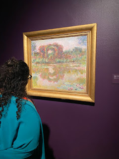 Person Looking at Art