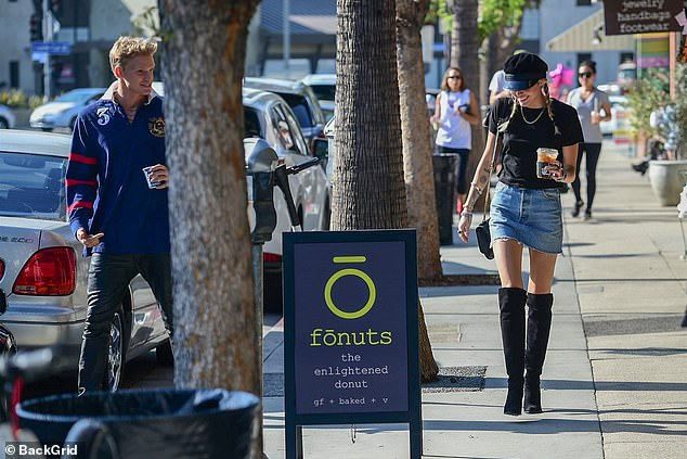 Miley Cyrus steps out with new Beau Cody Simpson all smiled up
