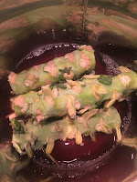 Photo of chunks of Brussels stalks stacked in a InstantPot with vegetable stalk. https://trimazing.com/