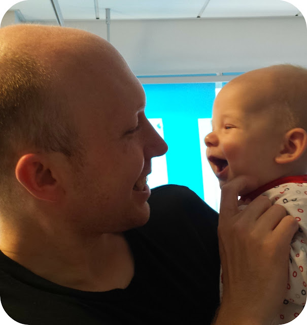 father and son, baby in hospital, father son smiles
