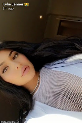 Kylie Jenner shows off massive cleavage in mesh top