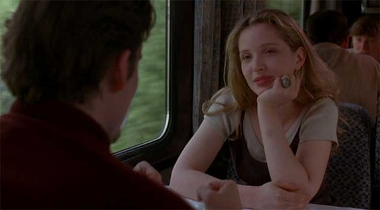 Ethan Hawke and Julie Delpy hang out in a train in Richard Linklater's Before Sunrise.